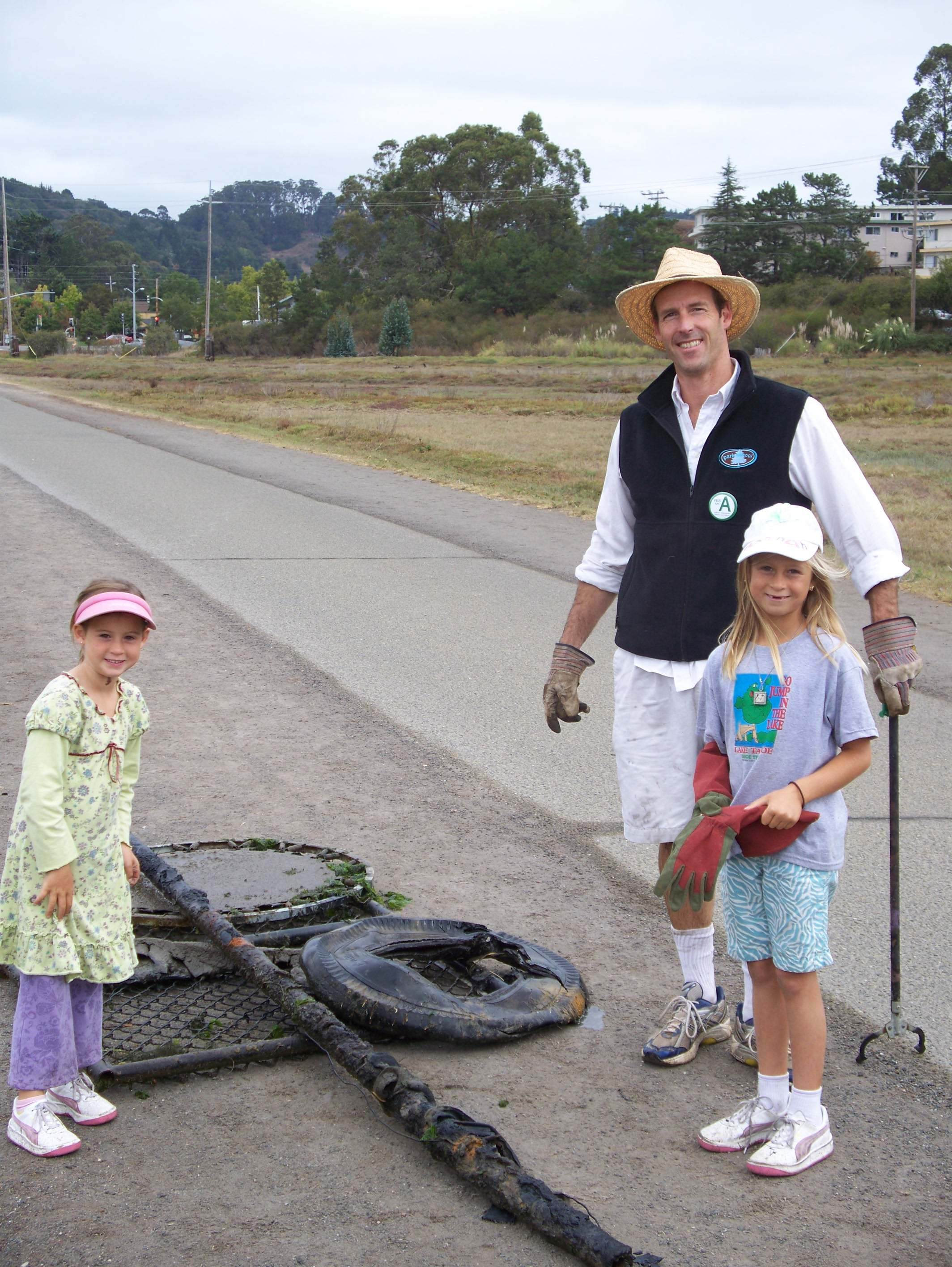 Coastal Cleanup Day 08 Family with trampoline, tire, etc.