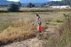 Sara Campos litter pick at McI with red sage and tam